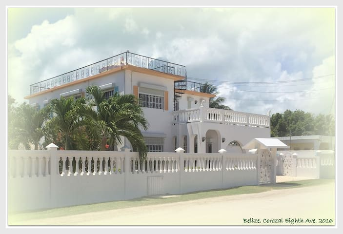 Your exclusive Coral Cottages address, whilst in Corozal - Eight Avenue, beautifully maintained, as of 2017.