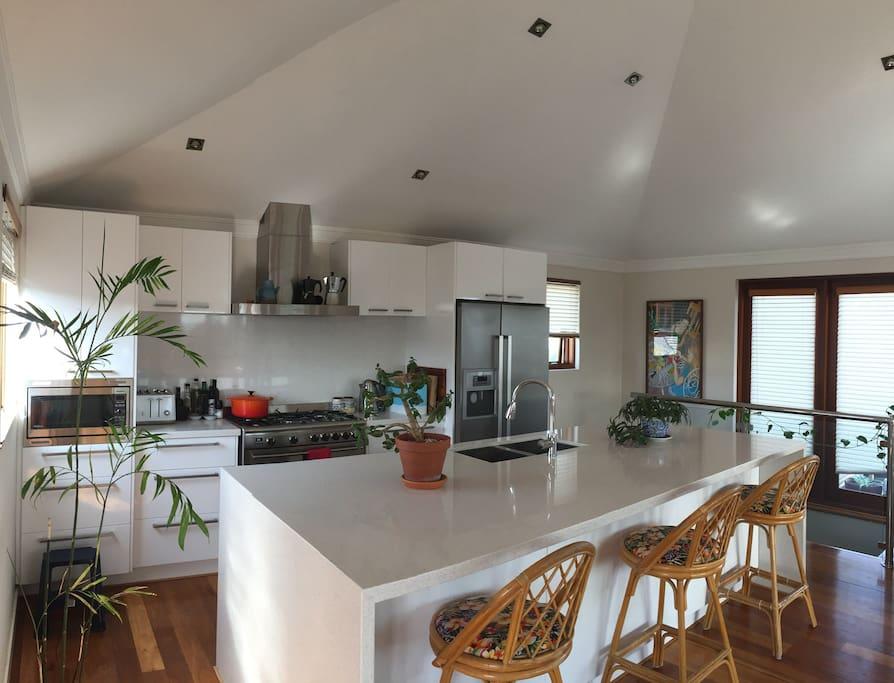 Kitchen with range oven and dishwasher.