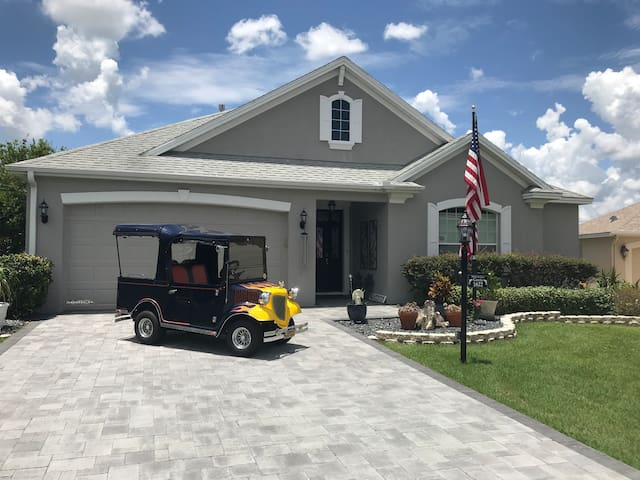 Yesteryear golf cart and house