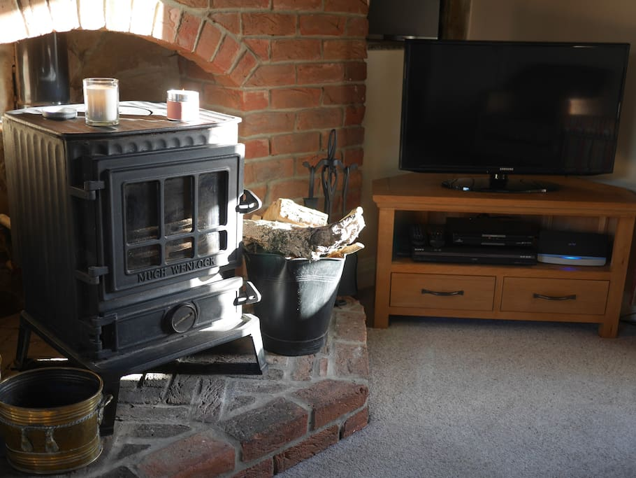 Contrast of the old (stove) and new (HD TV/Internet)
