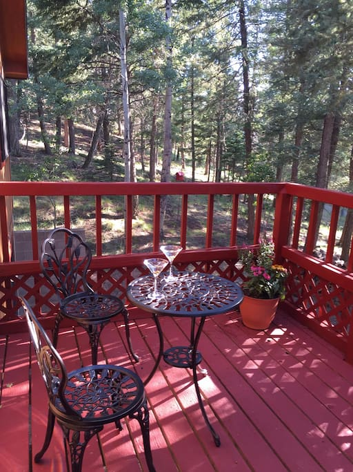 Deck looking out to trees, wildlife and fire pit