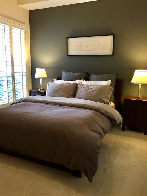 Guest bedroom with a queen size bed.