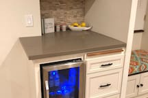 Media room kitchenette with microwave and beverage refrigerator