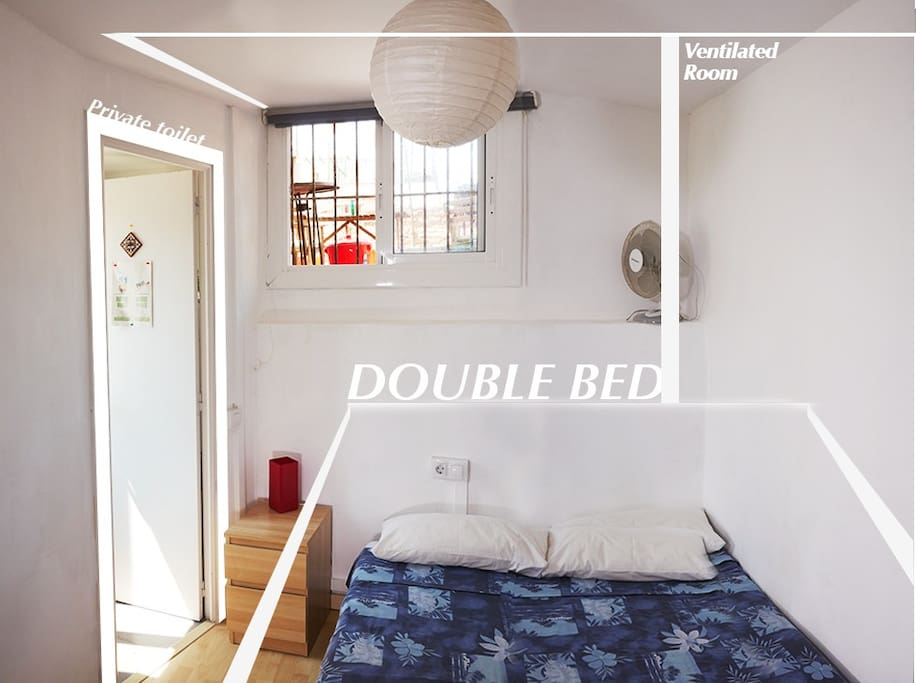 A small room with double bed