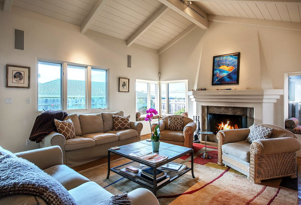 Spacious comfortable living room with a wood burning fireplace.
