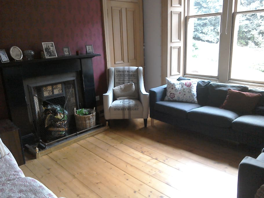 Sitting room - the (private) space where your bed will be. The chair will be replaced by an open wooden wardrobe.