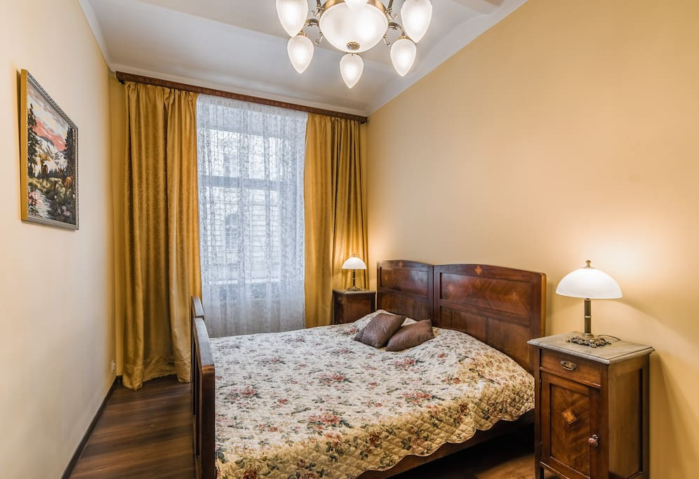 Bedroom with a king size bed and a view over the old part of town