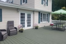 Beautiful deck with table awning and lounge chairs