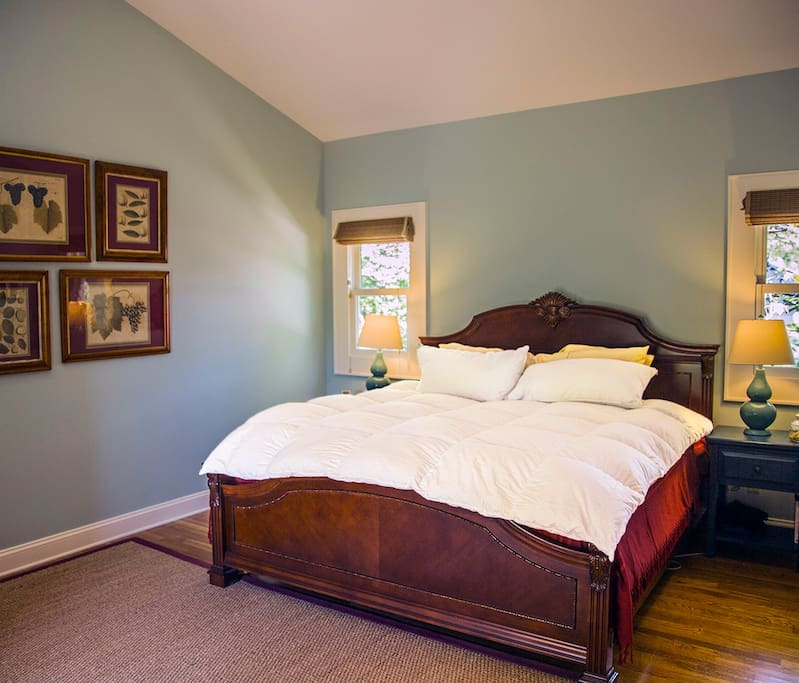 BEDROOM has a king size bed with plush quilted and padded layers under a vaulted ceiling for a restful night.