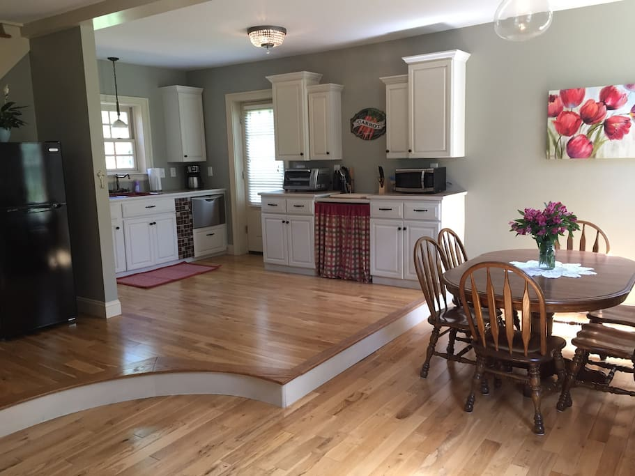 Open kitchen with eat in dining area