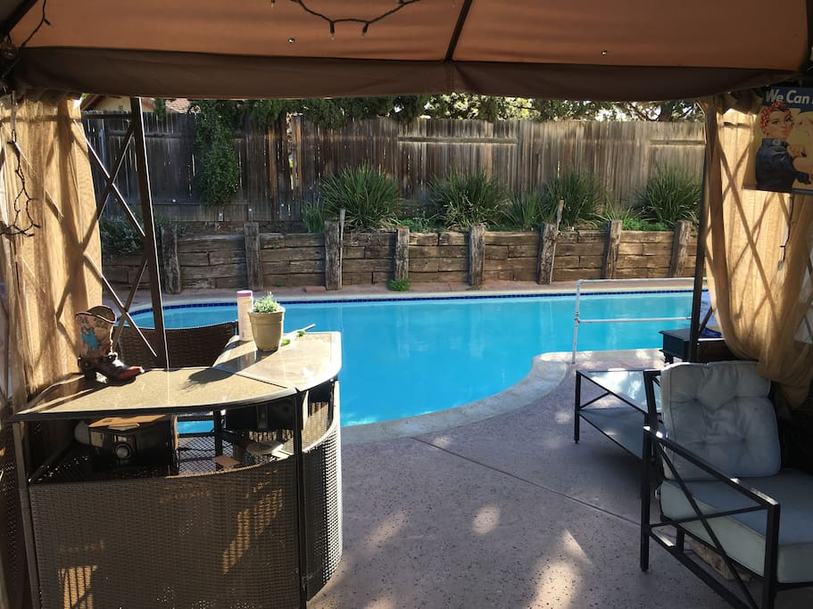 Shared patio, bar, and pool