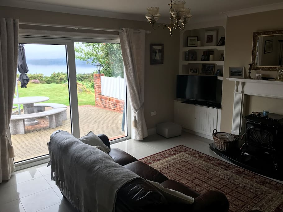 Comfortable living room with log burning stove and an unrivalled view over the Atlantic