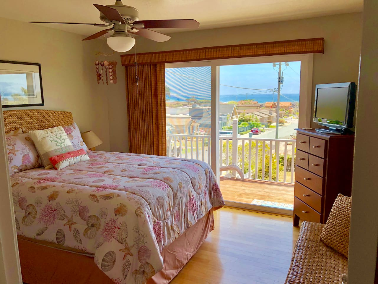 Master bedroom with balcony and ocean view