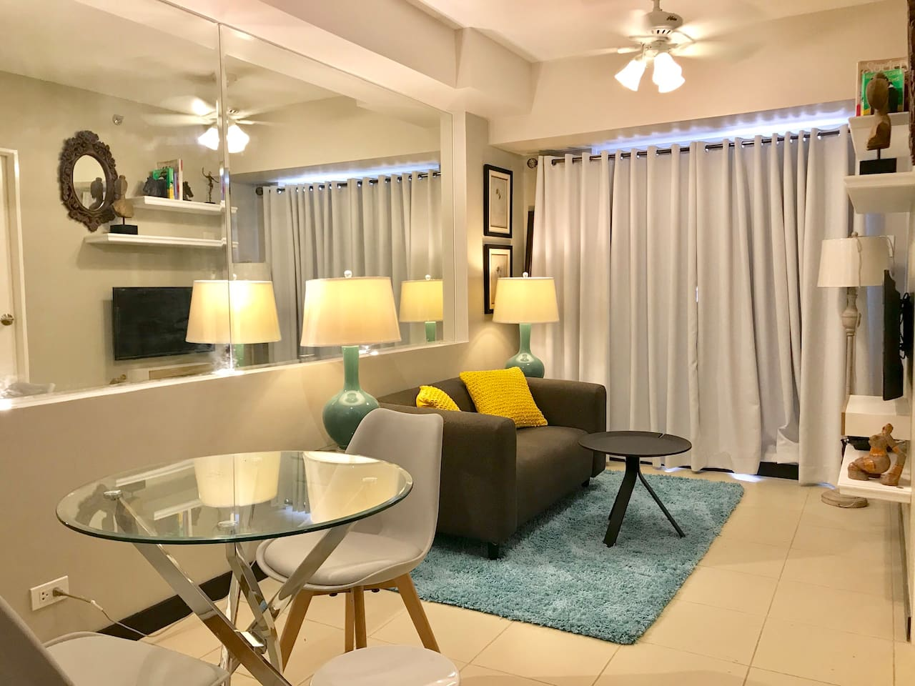 Dinning table for four, 2 seater sofa, coffee table, ceiling fan, flat screen tv, pldt fiber optic wifi tv, balcony  PLDT FIBER INTERNET  CIGNAL HIGH DEFINITION cable tv