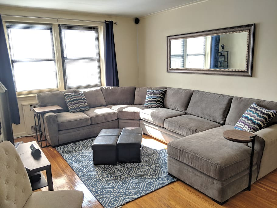 Large, plush sectional couch! Drenched with sun in this top floor apartment.