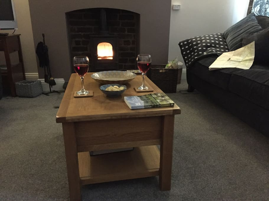 light airy spacious lounge with big comfy sofas, a Stovax wood burner on a green slate hearth