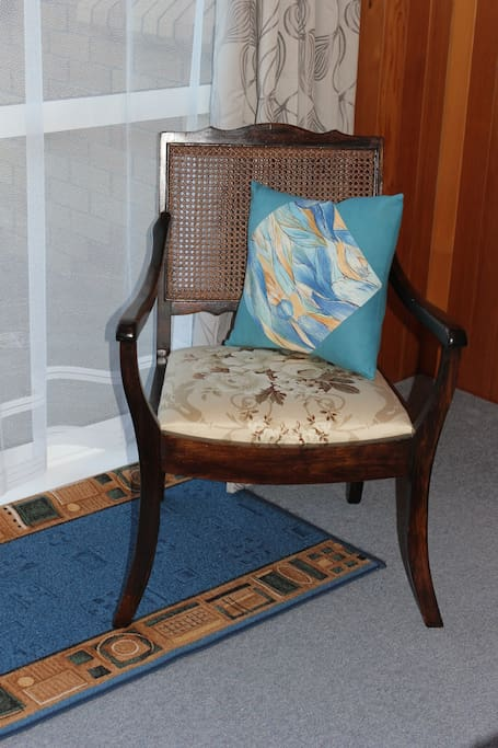 an antique chair in the bedroom