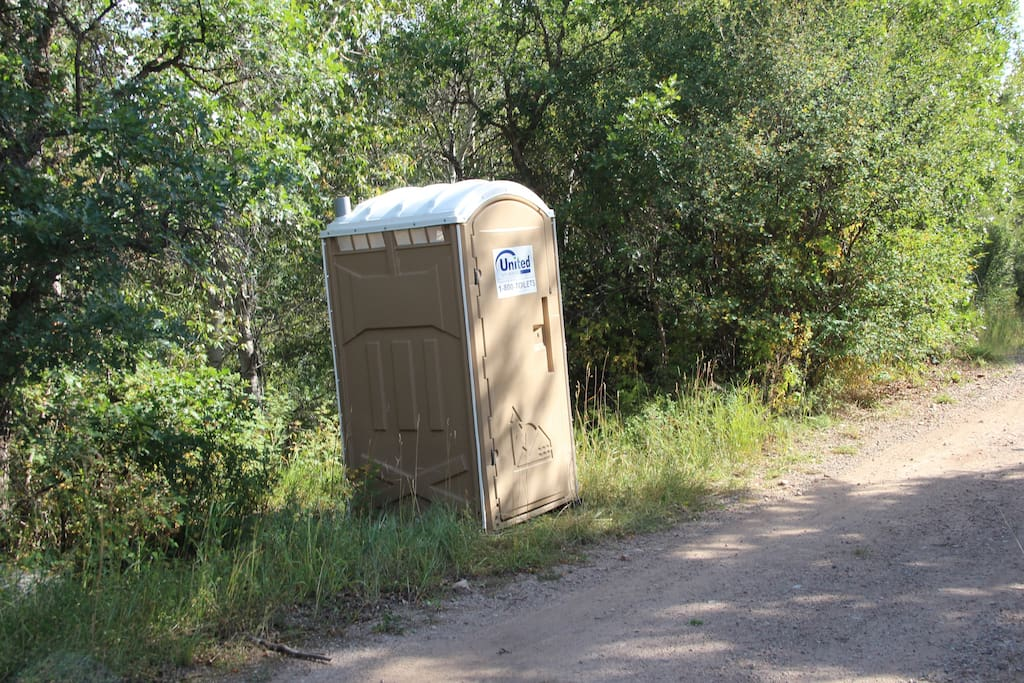 Port-a-potty just steps away. Washroom with showers and toilets is 10 minutes walk (or 1 minute drive) away.