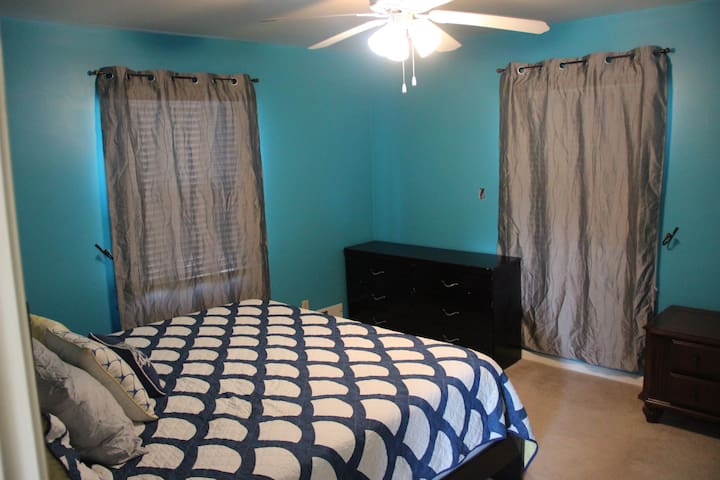 Upstairs bedroom with king bed and closet