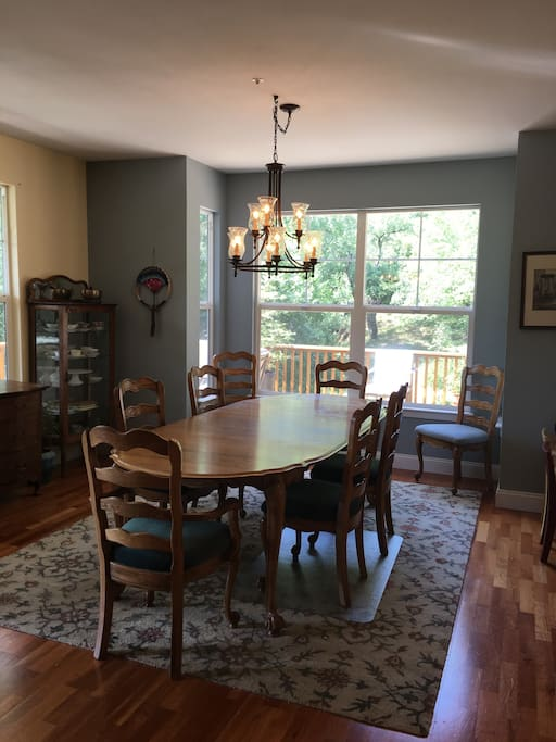 Spacious dining room open with view into kitchen for easy entertaining