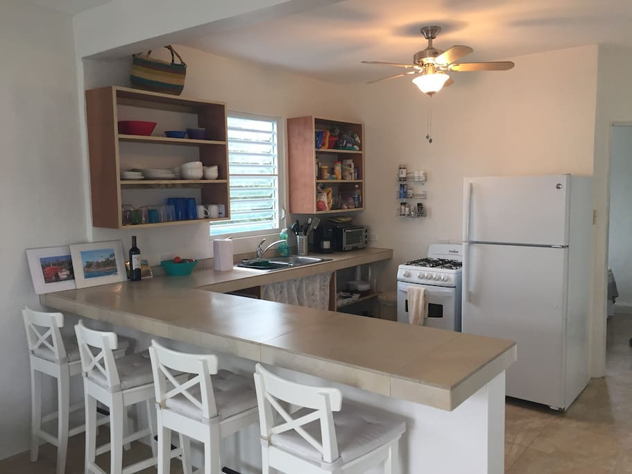 Spacious, modern, well equipped kitchen with breakfast bar.  Breakfast on the deck overlooking the ocean, however, is amazing!