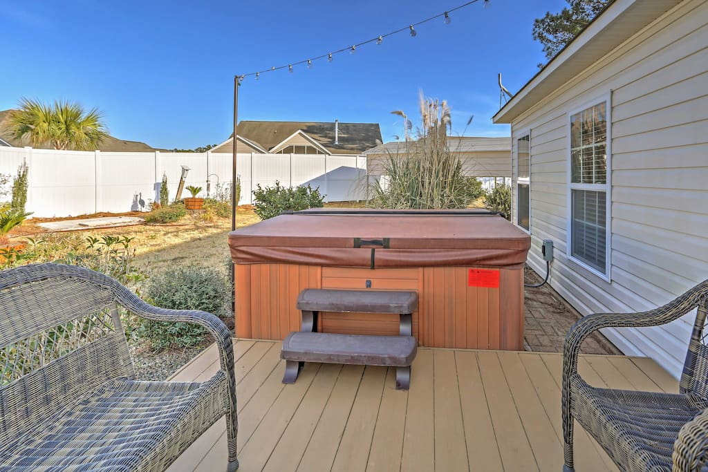 Look forward to unwinding in the soothing waters of the private hot tub.