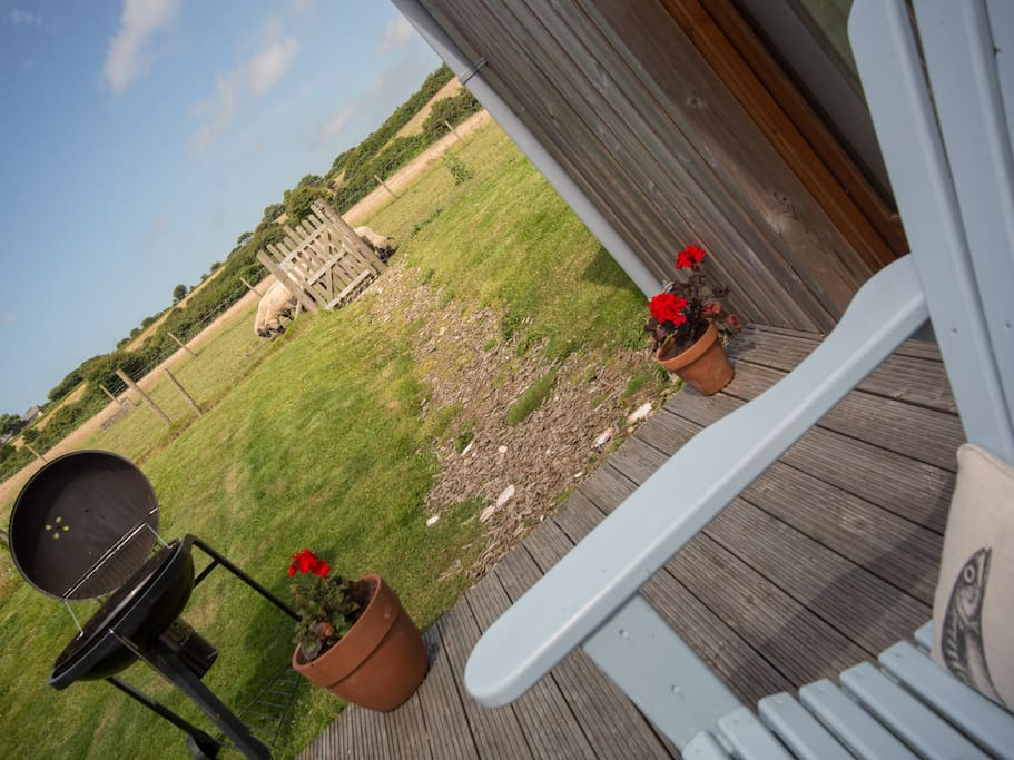 Sit on the decking looking onto open fields and watch the sun setting