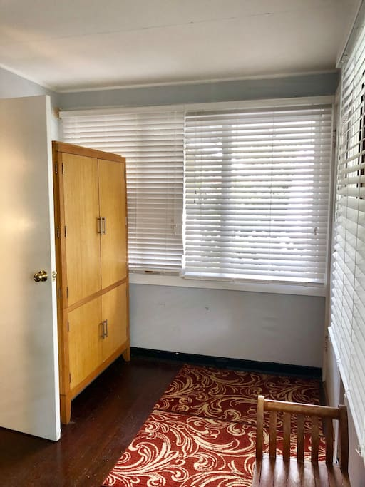 Armoire in front bedroom with antique Chinese twin bed