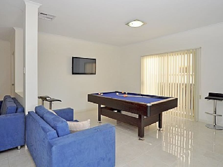 Rumpus room with TV and DVD, pool table that can be converted to a table tennis table