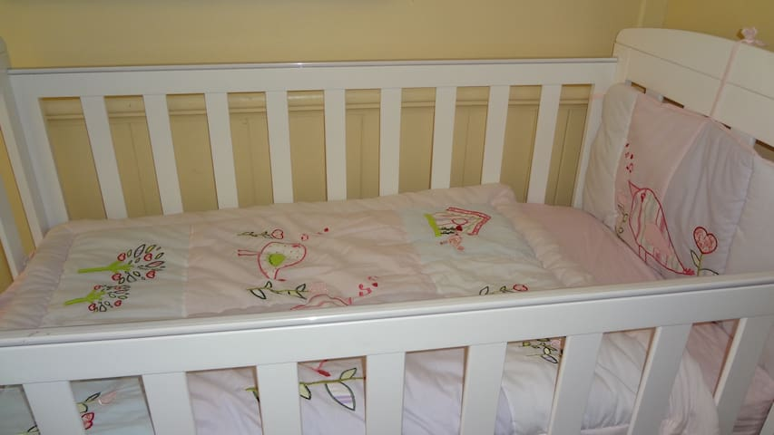 Cot, suitable for younger babies, and highchair available on request.