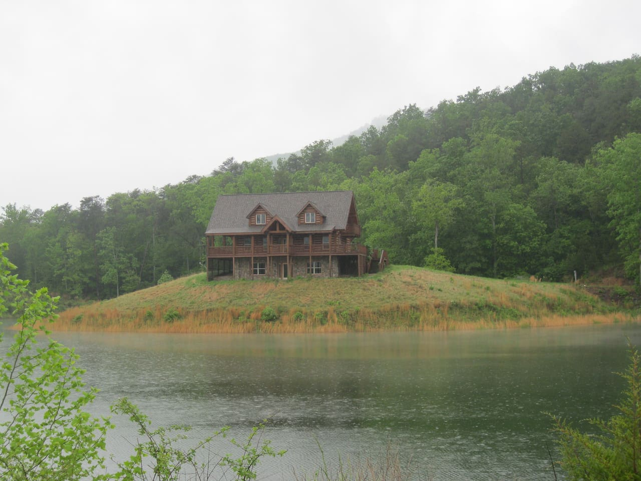Front of house as you drive in with private lake a surrounding mountains.