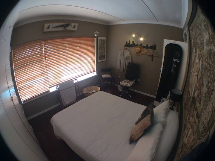 Large bedroom with kitchenette and en suite bath