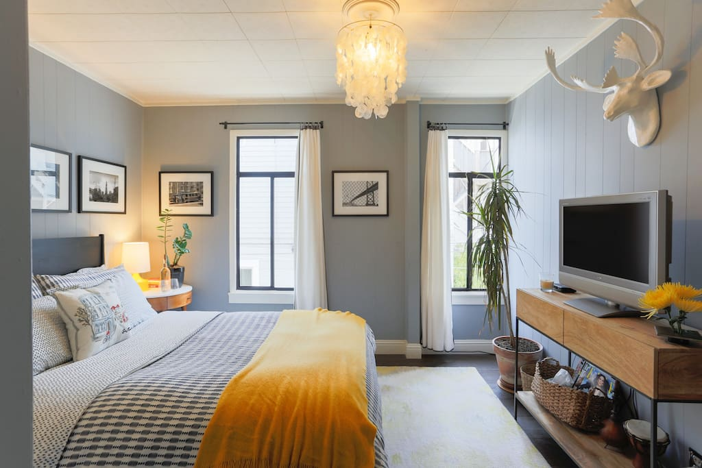 Your guest bedroom sleeps 2 with a queen size bed and down-filled duvet.  It's super cozy and quiet!