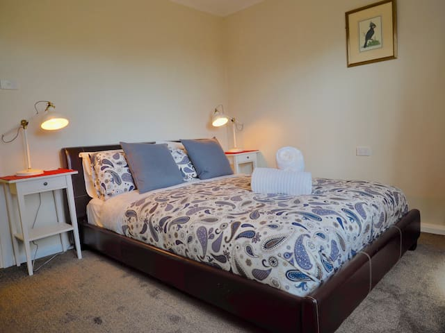 The master bedroom, a comfortable bed to rest in after a day of exploring the beautiful Blue Mountains
