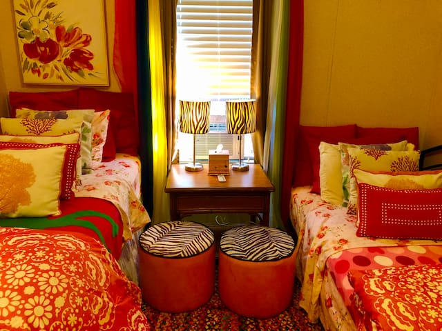 The second bedroom has 2 two twin beds, a small closet, desk and reading chairs. Perfectly decorated for kids and teens.