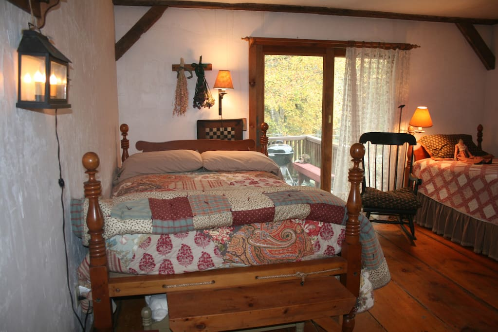 In the main bedroom is a queen sized antique rope bed and a single bed