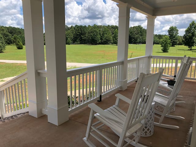 Rocking chairs across front porch