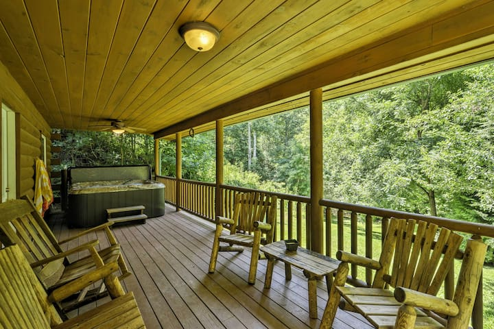 The spacious deck is the perfect spot to lounge around on the chairs and soak in the private hot tub.