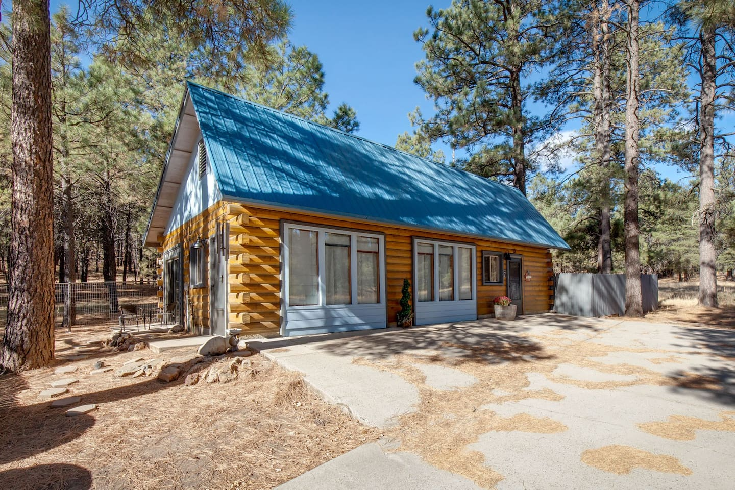 deck mountain flagstaff rentals show white cabins low in pines cabin peaceful arizona