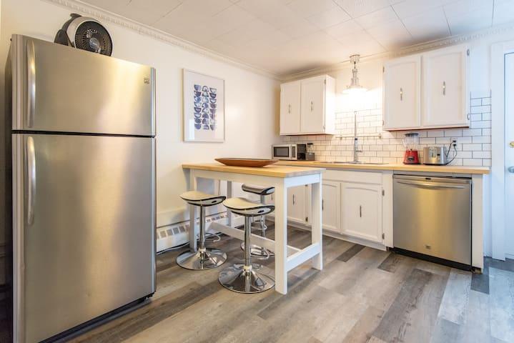 Enjoy the full kitchen with dishwasher, full fridge, stove and microwave.