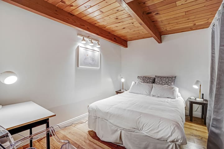 Bedroom with queen bed and small desk to work from cabin