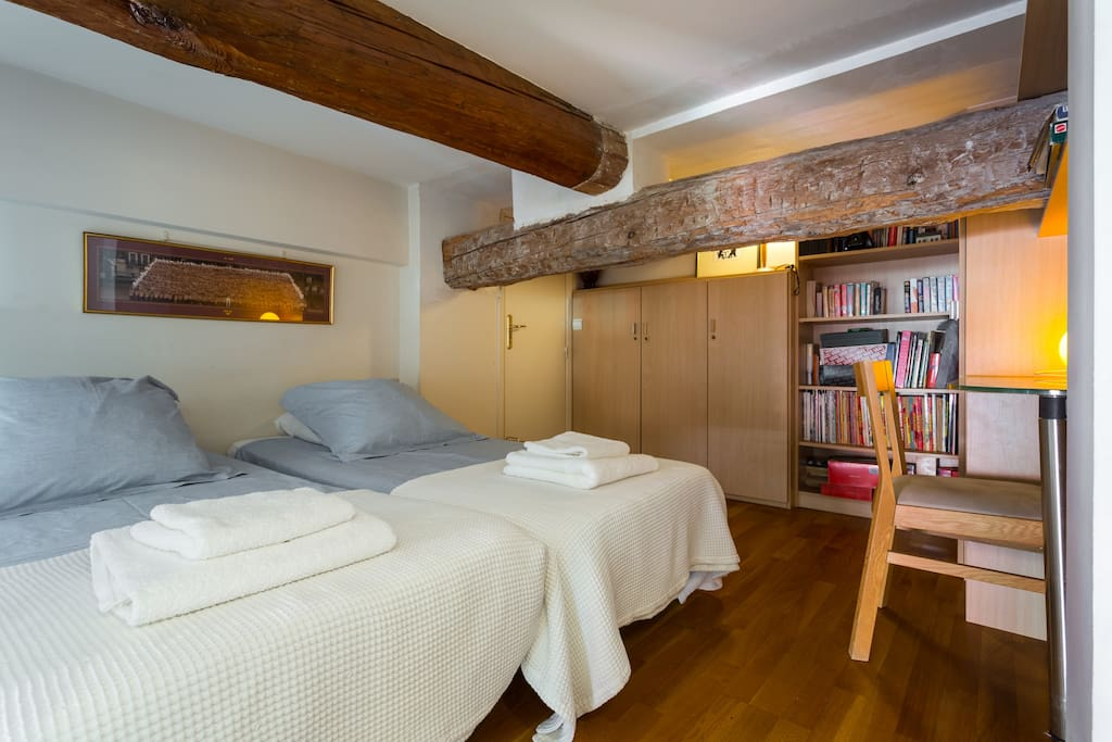 Large double bedroom (ceiling heights 1.80m average height); built in wardrobed, dressing table and ancient beams.