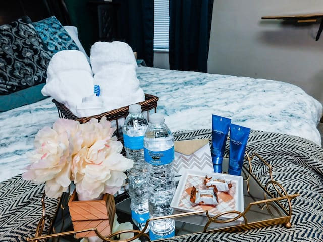 """Welcome basket in the """"men's"""" room designed with you in mind! A bit of sugar and hydration makes for a good day!"""