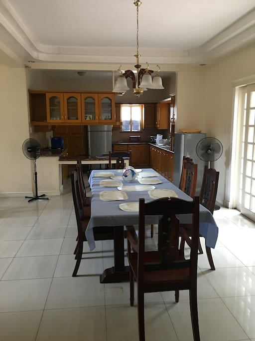 The dining room with table for 8 and the kitchen at the back! Shared.