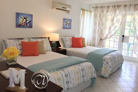 M @ Mystic Ridge is a modern American-style air conditioned hotel room featuring  a King size bed, flat screen TV (including cable), free WI-FI, balcony and kitchenette.