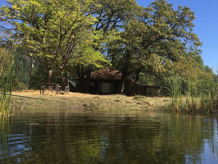 Rustic backwoods cabin on a pond