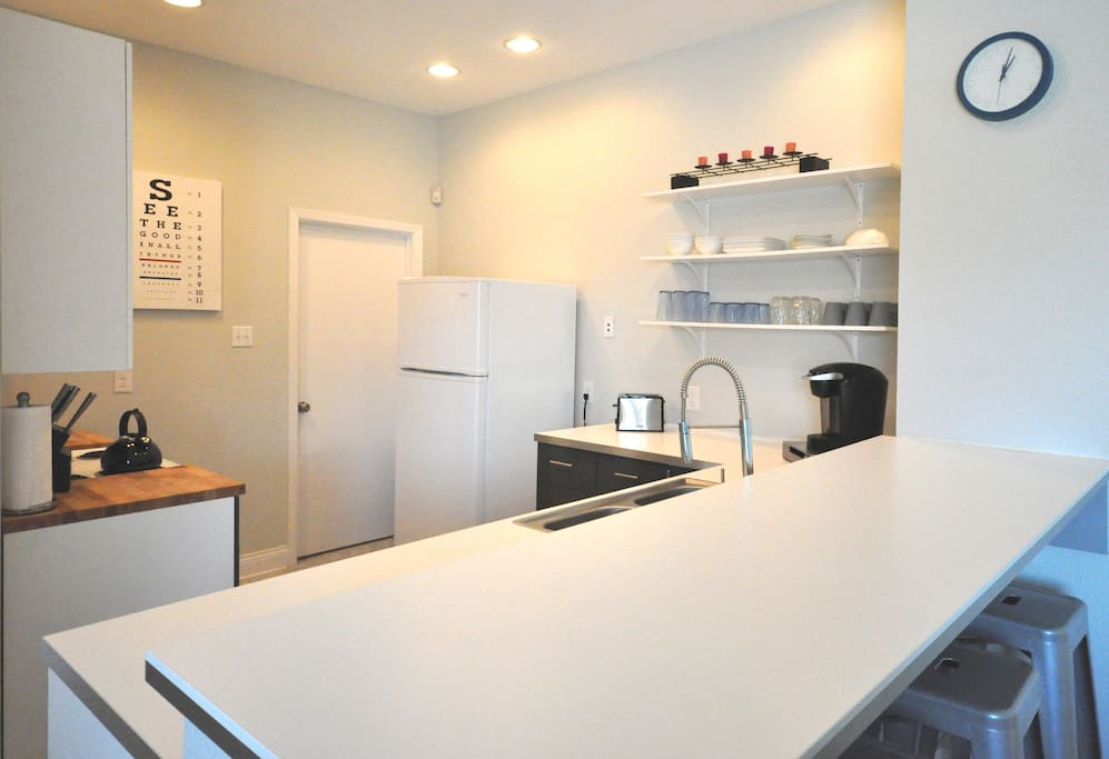 The kitchen features a breakfast bar with stools to enjoy your Keurig brewed coffee made just the way you like it.