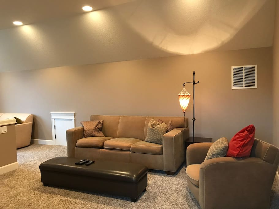 large living room with cable tv and PS4