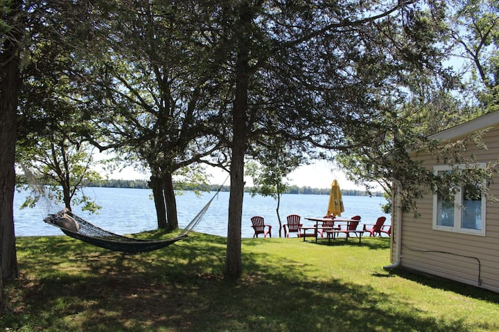 Roblin Lake Escape - Pet-friendly waterfront cottage with firepit and dock in Prince Edward County
