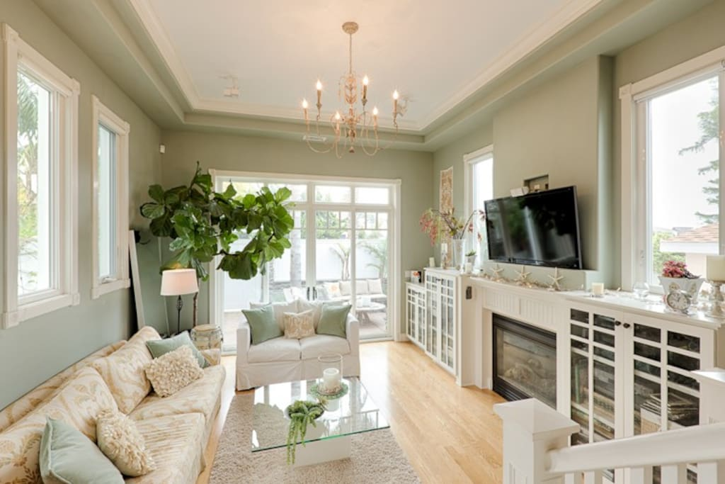 Spacious living room has plenty of seating for relaxing and family time
